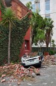 Christchurch Earthquake - Car Crushed By Brick Wall In Montreal Street.