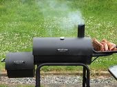 Backyard Barbequing On A Charcoal Smoker
