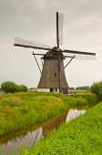 Dutch Windmill Along A Reflecting Ditch