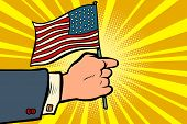 Hand With The American Flag. Independence Day. Patriotic Symbol. Comic Cartoon Pop Art Retro Vector  poster