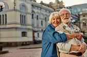 True Love Has No Expiration Date. Portrait Of Cheerful Senior Couple In Casual Clothing Embracing Ea poster