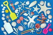 Symbols of the seaside in summer background with seashells, beach toys, rock candy, sailboat, driftw poster