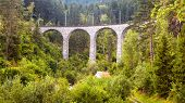 Landscape With High Bridge And Small House, Filisur, Switzerland. Panorama Of Alpine Forest. Scenic  poster