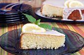 Lemon Cake Garnished With A Slice Of Lemon And Lemon Mint.