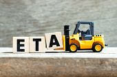 Toy Forklift Hold Letter Block A To Complete Word Eta (abbreviation Of Estimated Time Of Arrival) On poster