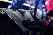 Orchestra Music Stands. Performance On The Stage Of A Brass Symphony Orchestra. Musician Reads Music poster