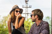 Couple In Love Smiling Outdoors. Happy People Lifestyle. Happy Hipster Couple Smiling Outdoor. Trave poster