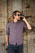 Man Speaking On The Phone. Man Speaking On The Cell Phone. Portrait Of Man Speaking On The Cell Phon poster