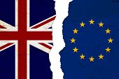 British And Eu Flags That Are Torn Apart Showing Brexit The Bad Relationship Between The Two Countri poster