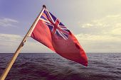 The Uk Red Ensign The British Maritime Flag Flown From Yacht Sail Boat, Blue Sky And Baltic Sea. Sum poster