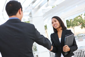 picture of male female  - Attractive man and woman business team shaking hands at office building - JPG