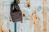 Old Padlock On Rusty Door