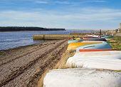 Upturned boats on beach