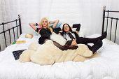 Two Attractive Schoolgirls In The Bed