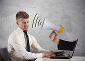 stock photo of yell  - Web advertising and spam concept with businessman and megaphone - JPG