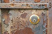 Old Rusty Metal Plate And Lock Heavily Aged And Corroded