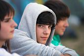 stock photo of hoods  - Three teenagers sat together - JPG