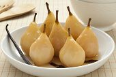 Whole poached  Gieser Wildeman pears in white wine with vanilla and cinnamon