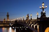 picture of nightfall  - Alexander III bridge in the city of Paris France - JPG