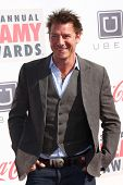 LOS ANGELES - FEB 17:  Ty Pennington arrives at the 2013 Streamy Awards at the Hollywood Palladium on February 17, 2013 in Los Angeles, CA