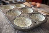 Buttered Muffin Tin With Corn Flour