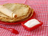 Pile Of Pancakes And Sour Cream On Shrovetide
