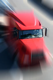 image of tractor-trailer  - red truck blur image - JPG