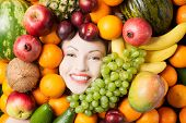 Woman face in fruits, healthy nutrition and diet concept.