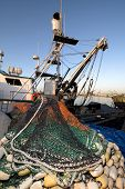 A commercial fishing boat with a purse sein net staged for a fishing trip