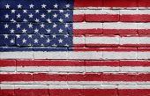 Flag of the USA on brick wall