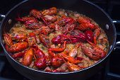stock photo of crawfish  - A beautiful skillet full of crawfish jambalaya. This dish was created in the southern United States in Lousiana.