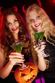 stock photo of scorpion  - Photo of smiling females holding Halloween pumpkin and cocktails with scorpions - JPG