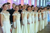 MOSCOW - FEB 22: The girls dressed in white dresses on the Kremlin Cadet Ball in Manege, on February