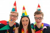 Identically adult male twins having birthday together with girl in studio