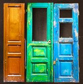 pic of wooden door  - Three colored old wooden scratched cracked paint doors background - JPG