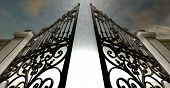 picture of gates heaven  - A set of ornate gates to heaven opening under an ethereal light and cloudy afterlife - JPG