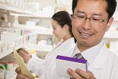 Pharmacist examining prescription medication in a pharmacy