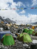 stock photo of sherpa  - The colorful tents of Everest Base Camp dot the landscape at the foot of Mount Everest in Nepal - JPG