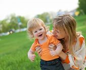 Happy mother and her little son outdoors session