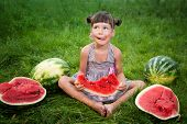 Funny girl eating watermelon