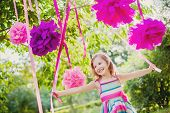 stock photo of pom poms  - girl celebrating birthday in park - JPG