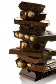 four kind of chocolate tower on white background