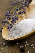 bath salt in a wooden spoon with lavender