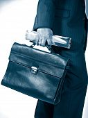 businessman with bag and newspaper in blue tone