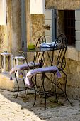 Chairs and table in a mediterran city