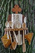 image of household farm  - Romanian traditional objects carved from wood and exposed on bark of a tree - JPG