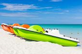 Colorful pedalos docked at the shore of the tropical beach of Varadero in Cuba