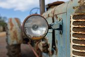picture of tractor  - The headlight of abandoned rusty vintage tractor - JPG