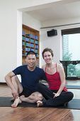 stock photo of bending over backwards  - Two people relaxing in a yoga studio - JPG