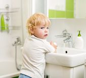 stock photo of wash-basin  - kid washing hands with soap in bathroom - JPG